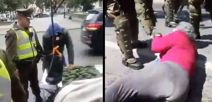 VIDEOS: Carabineros le roban las paltas a unos vendedores y botan al suelo una anciana en marcha mapuche